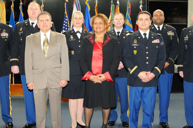 This quarter's retirees honored at the retirement ceremony Jan. 18. Back row: CW4 Wolfe R. Fite, CW4 Blain Fuller, Maj. Theo Britt, CW4 Lucas Whittington, Staff Sgt. Leroy Whatley and Chaplain (Col.) Scott R. Sherretz. Front row: Tony Lascano, Vicki Flowers and CW4 Victor J. Negron.