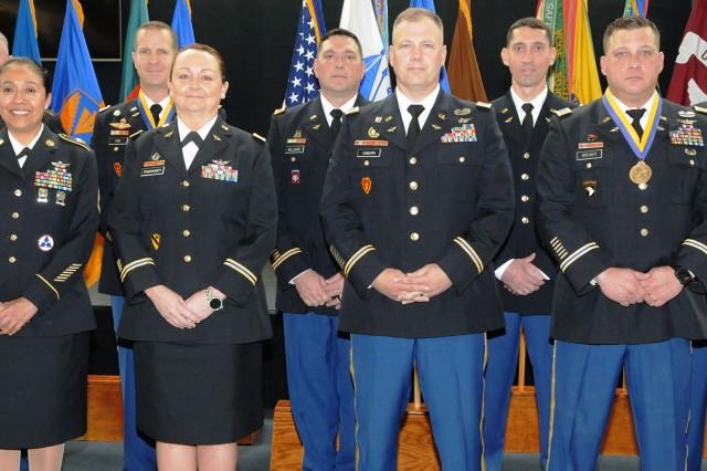 Back row: Command Sgt. Maj. Troy S. Hubbs, CW4 Daniel Fox, CW4 John I. Williams Jr., CW3 Tyrell White and CW4 George Aldridge III. Front row: Sgt. 1st Class Araceli Hurtado, CW3 Rebecca Pinckney, CW3 Travis Ogburn and CW3 David Bremer.