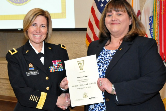 Brig. Gen. Michelle M. T. Letcher, Commander, Joint Munitions Command, presents the Senior Executive Service membership certificate to JoEtta Fisher, during the official promotion ceremony at the Rock Island Arsenal, Jan. 22.