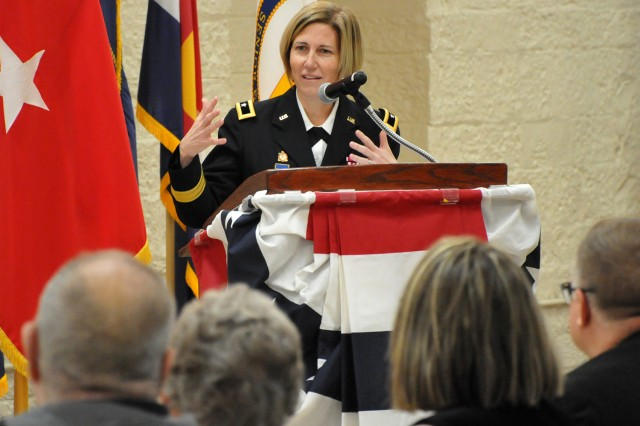 Brig. Gen. Michelle M. T. Letcher, Commander, Joint Munitions Command, provides remarks during JoEtta Fisher's official SES promotion ceremony at the Rock Island Arsenal, Jan. 22.