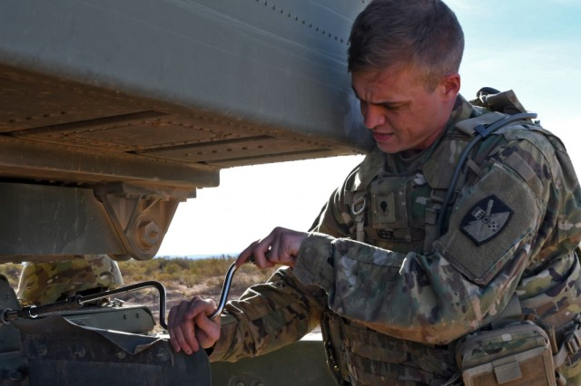 Spc. Jordan Meek, an Army National Guard Soldier for Alpha Battery, 5th Battalion, 113th Field Artillery Regiment, North Carolina Army National Guard, utilizes a socket wrench to rectify the launcher module's alignment prior to the unit's familiarization exercise performed at Orogrande Range Complex, N.M.