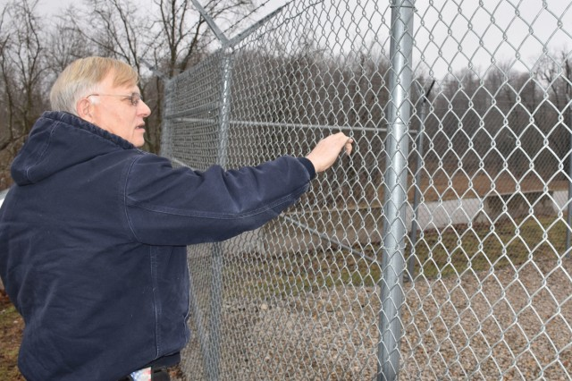 Michael A. Reynolds, Blue Grass Chemical Activity surety specialist, inspects the fence surrounding the chemical limited area at the Blue Grass Army Depot on Jan. 15, 2019.