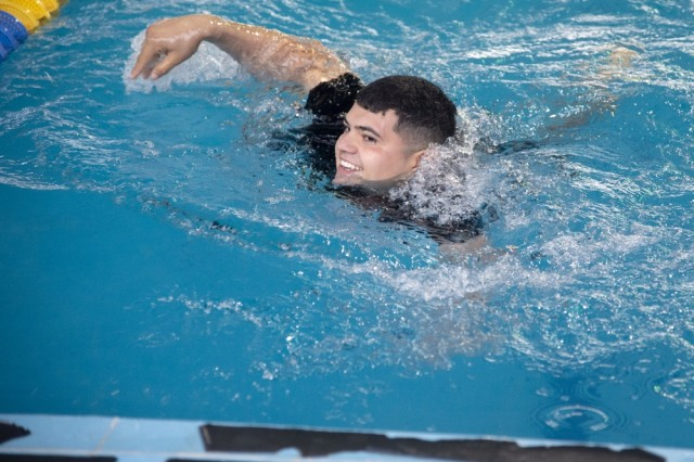 U.S. Army Spc. Alejandro Leal Austin, Delta Company, 3-141st Infantry Regiment, Task Force Alamo, Texas National Guard, assigned to Combined Joint Task Force-Horn of Africa (CJTF-HOA), Djibouti, competes in a swim competition for the German Armed Forces Badge (GAFB) for Military Proficiency in Djibouti, Jan. 16, 2019. The GAFB is awarded to and worn by German service members of all ranks. Allied service members may also be awarded the badge, subject to their nations' uniform regulations.
