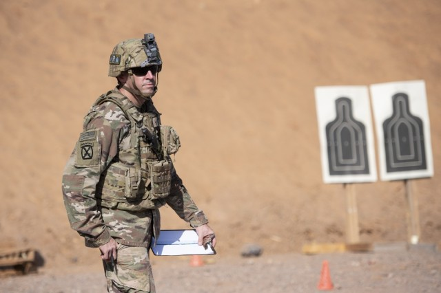 A U.S. Army Soldier from 1-141 Infantry Regiment, Task Force Alamo, Texas National Guard, assigned to Combined Joint Task Force-Horn of Africa, officiates the official marksmanship portion of the German Armed Forces Badge for military proficiency at the Arta Range Complex, Djibouti, Jan. 17, 2019. Competing for the badge offered a unique opportunity to Soldiers and worked as an information exchange between the U.S. and Germany militaries.