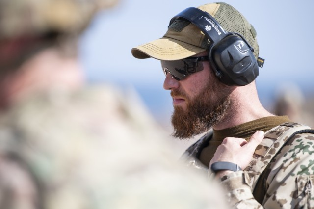 German Army Sgt. 1st Class Tobias Maul, information technology specialist and combat arms training instructor, assigned to Operation Atlanta, officiates the marksmanship portion of the German Armed Forces Badge for military proficiency at the Arta Range Complex, Djibouti, Jan. 17, 2019. Competing for the badge offered a unique opportunity to Soldiers and worked as an information exchange between the U.S. and Germany militaries.