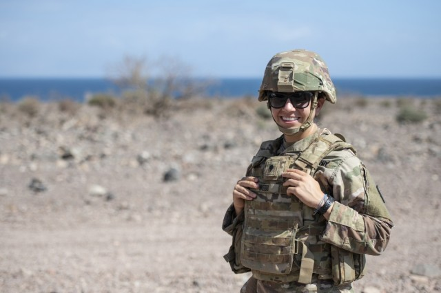 U.S. Army Spc. Natalia Webb, a medical technician from 1-141 Infantry Regiment, Task Force Alamo, Texas National Guard, assigned to CJTF-HOA, and the only female to earn the German Armed Forces Badge for military proficiency (GAFB) this rotation, poses for a photo during the marksmanship portion of the GAFB at the Arta Range Complex, Djibouti, Jan. 17, 2019. Competing for the badge offered a unique opportunity to Soldiers and worked as an information exchange between the U.S. and Germany militaries.