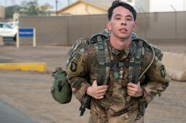 """U.S. Army Pfc. Tristan Seaton, Bravo Company, 1-26 Infantry, 101st Airborne, assigned to Combined Joint Task Force-Horn of Africa (CJTF-HOA), Djibouti, competes in a """"ruckrun"""" for the German Armed Forces Badge (GAFB) for Military Proficiency in Djibouti, Jan. 15, 2019. The GAFB is awarded to and worn by German service members of all ranks. Allied service members may also be awarded the badge, subject to their nations' uniform regulations."""