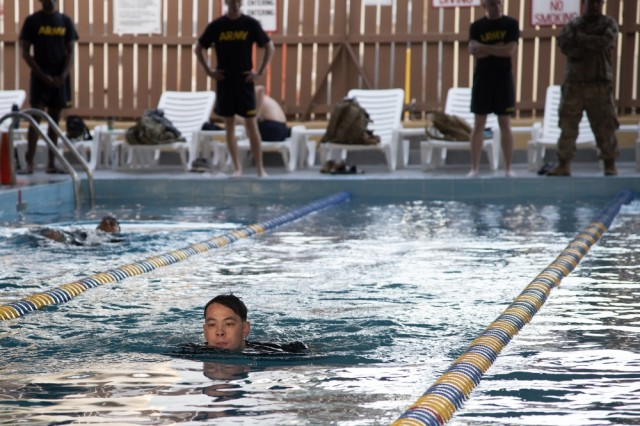 U.S. Army Pfc. Tristan Seaton, Bravo Company, 1-26 Infantry, 101st Airborne, assigned to Combined Joint Task Force-Horn of Africa (CJTF-HOA), Djibouti, competes in a swim competition for the German Armed Forces Badge (GAFB) for Military Proficiency in Djibouti, Jan. 16, 2019. The GAFB is awarded to and worn by German service members of all ranks. Allied service members may also be awarded the badge, subject to their nations' uniform regulations.