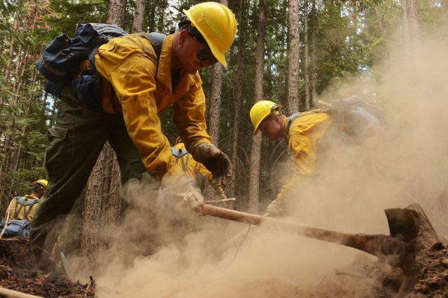 176th Engineer Company, clears hot spots along the fire line of the Sheep Creek fire Aug. 5, 2018, near Northport, Wash. Price is a member of a 20-person hand crew, that is one of five crews made up of Washington Army and Air National Guardsmen.