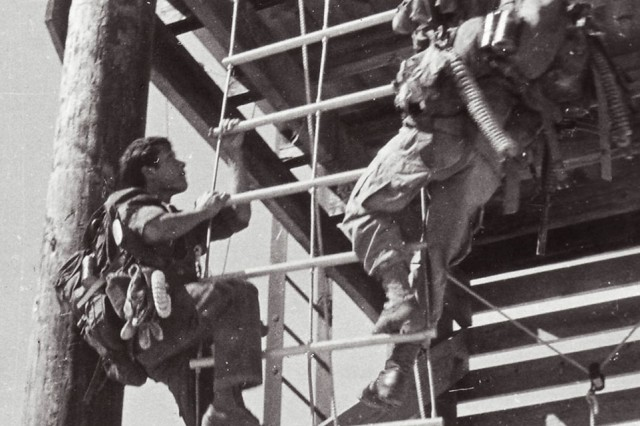 Command and control reconnaissance team-moccasin practices flexible ladder training at base camp. Such ladders were used for helicopter infiltration and exfiltration.