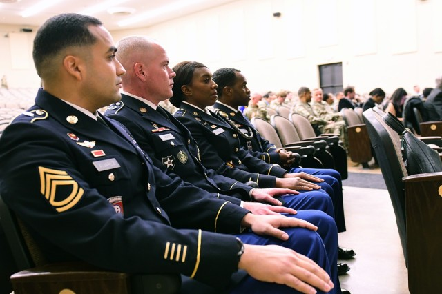 (from left) Sgt. 1st Class Angel Alvarez of U.S. Army Human Resources Command, Sgt. 1st Class Robert Holmes of Recruiting & Retention College, Sgt. 1st Class Aisha Mason of 83rd U.S. Army Reserve Readiness Training Center, and Sgt. Nahjier Williams of 1st Theater Sustainment Command sit in Olive Theater at Fort Knox, Kentucky, Jan. 22, 2019, waiting for the start of their Sergeant Audie Murphy Club induction ceremony.