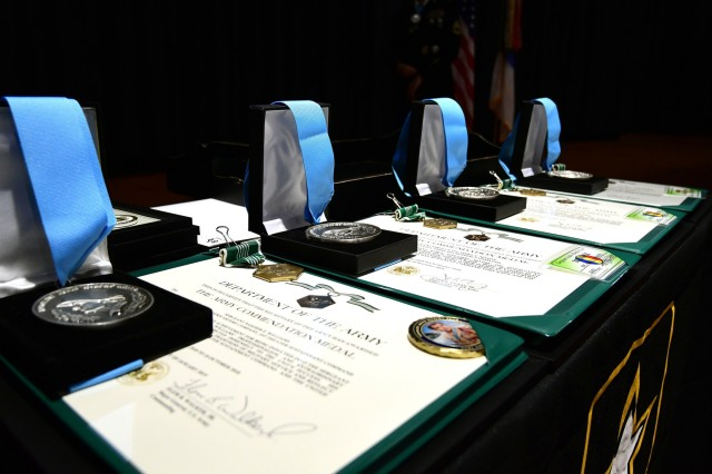 Four Sergeant Audie Murphy Club medals sit on a table in Olive Theater at Fort Knox, Kentucky, Jan. 22, 2019, as four new inductees prepared to receive them. Along with the medals, each Soldier also received an Army Commendation Medal.