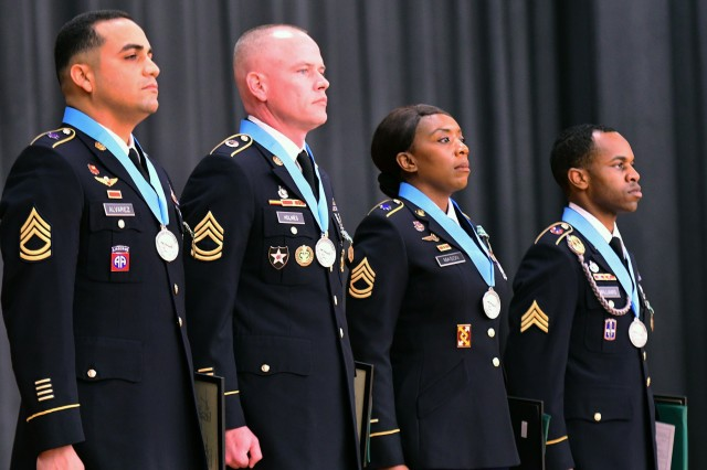 The four Fort Knox Soldiers, from 1st Theater Sustainment Command, U.S. Army Human Resources Command, Recruiting & Retention College and 83rd U.S. Army Reserve Readiness Training Center, stand before a crowd of fellow Sergeant Audie Murphy Club members and local civic and military leaders after being presented their medals Jan. 22, 2019.