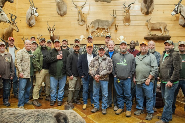 The hunters and guides for Anniston Army Depot's 2019 Wounded Warrior Hunt gathered with ANAD Commander Col. Joel Warhurst for a group photo Jan. 18 following the hunt's opening dinner.