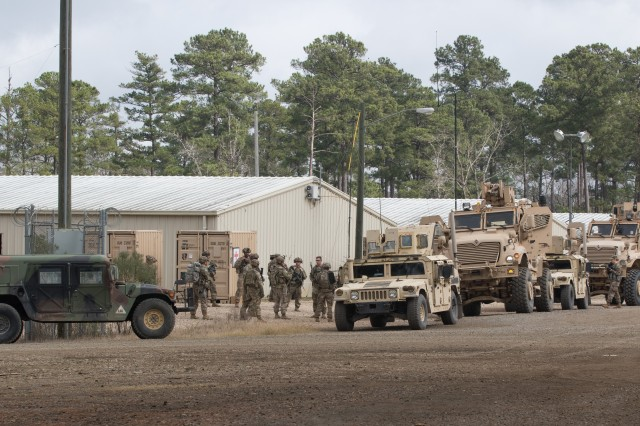 U.S. Advisors from the 2nd Security Force Assistance Brigade based out of Fort Bragg, N.C., gather as they prepare to be briefed on vehicle movement and evacuation procedures at the Joint Readiness Training Center at Fort Polk, La., Jan. 17, 2019. The 2nd SFAB is conducting pre-deployment training at the Joint Readiness Training Center as they prepare to deploy to Afghanistan in the spring of 2019 to provide training and advising assistance to Afghan National Security Forces.