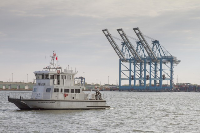 The Ewell, a U.S. Army Corps of Engineers Norfolk District survey vessel, sails past cranes at the Virginia Port Authority's Norfolk International Terminal. The first phase of Norfolk Harbor's deepening project is set to begin next January. (U.S. Army photo/Patrick Bloodgood)
