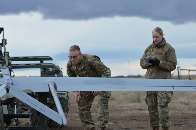 Idaho Army National Guard Sgt. Mellissa Baney and Spc. Scott Post conduct a pre-flight inspection of a D Company, 116th Brigade Engineer Battalion Shadow Jan. 17, 2019 at the Orchard Combat Training Center. Baney, a 15W unmanned aircraft systems operator, previously served in the U.S. Army before joining the Idaho Army National Guard to help pay for law school.