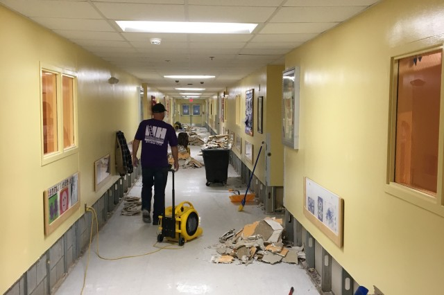 Workers repair water damage at the CDC.