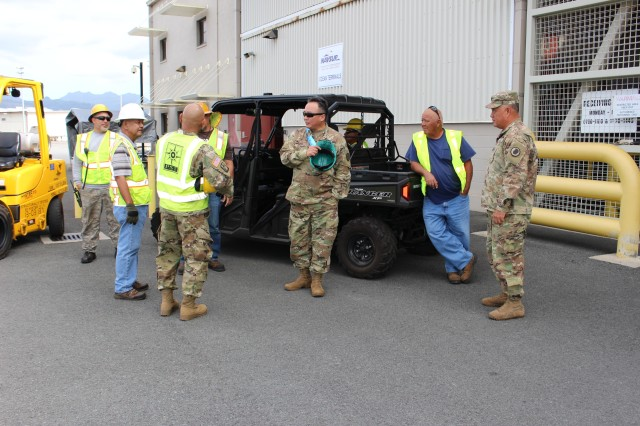 National Guard Soldiers, members of the 599th Transportation Brigade and Fleet Logistics Center Pearl Harbor discuss the move during port operations in support of the Hawaii Army National Guard at Pearl Harbor on Jan. 6.