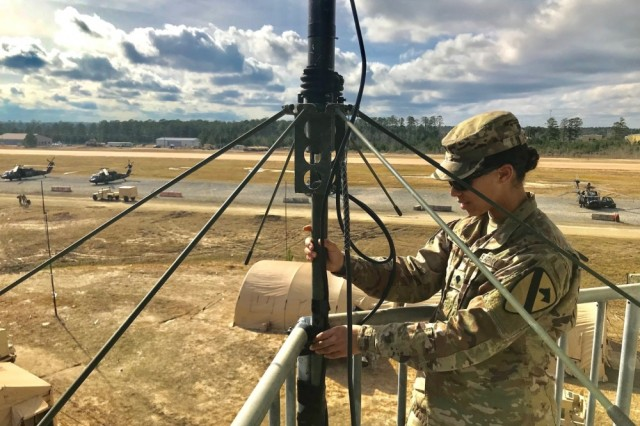 Army Spc. Akya Cowart, air traffic controller, F Company, 2nd Battalion, 227th Aviation Regiment, 1st Air Cavalry Brigade, 1st Cavalry Division, ensures an antenna is stable on the tower at Polk Army Airfield, Jan. 17. Cowart had the unique opportunity of controlling a V-22 Osprey along with other aircraft in Task Force Lobos at the Joint Readiness Training Center. TF Lobos' mission at JRTC was to support the 2nd Security Force Assistance Brigade.