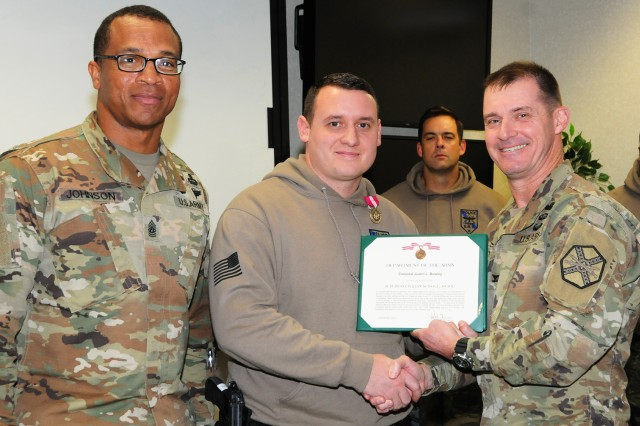 Command Sgt. Maj. Jasper C. Johnson, Fort Rucker garrison command sergeant major, and Col. Brian E. Walsh, garrison commander, present Cpl. Justin L. Bowley, Department of the Army civilian police officer with the Directorate of Public Safety, with the Superior Service Award Jan. 22 for his life-saving efforts at the scene of a vehicle accident within post jurisdiction in July.