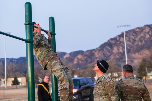 1st Lt. Nick Rodriguez, with 1st Battalion, 41st Infantry Regiment, 2nd Infantry Brigade Combat Team, 4th Infantry Division, conducts a pull-up Jan. 10, 2019, during a Ranger Physical Fitness Test (RPFT) at Iron Horse Park. The RPFT was the first of four events of the 4th Inf. Div. Best Ranger Competition tryouts.