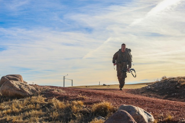 1st Lt. Connor Bestwick, with 1st Battalion, 41st Infantry Regiment, 2nd Infantry Brigade Combat Team, 4th Infantry Division, walks on a trail during an 8-mile ruck march Jan. 10, 2019, at Fort Carson. The ruck march was part of the 4th Inf. Div. Best Ranger Competition tryouts. This year marks the competition's 36th anniversary. The competition began in 1982 and still thrives today, testing the best Soldiers of the world in the U.S. Army through a grueling competition.