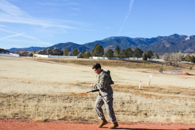 1st Lt. Clayton Stanley, with 2nd Battalion, 12th Infantry Regiment, 2nd Infantry Brigade Combat Team, 4th Infantry Division, runs up a hill Jan. 10, 2019, during a 2.5-mile Interceptor Body Armor run on Fort Carson. The run was part of the 4th Inf. Div. Best Ranger Competition tryouts.