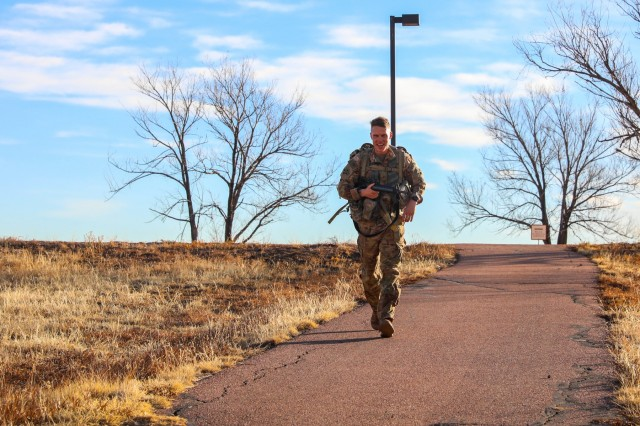 Chief Warrant Officer 2 Joshua Detwiler, with 2nd Battalion, 77th Field Artillery Regiment, 2nd Infantry Brigade Combat Team, 4th Infantry Division, runs down a hill during an 8-mile ruck march Jan. 10, 2019. The ruck march was part of the 4th Inf. Div. Best Ranger Competition tryouts.