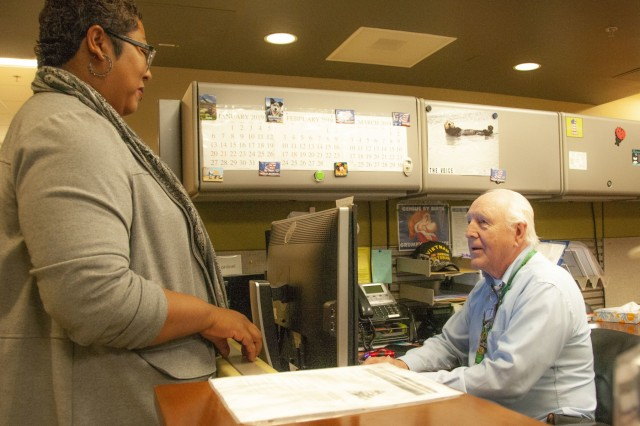 Douglas Preston, Medical Support Assistant, Family Care Clinic, Spc. Hugo V. Mendoza Soldier Family Care Center, Fort Bliss, Texas, discusses appointment information with a patient during a routine check up at the Family Care Clinic, Jan. 11. Recently, WBAMC introduced the Commander's MSA Award to recognize and incentivize excellent front dest customer service.