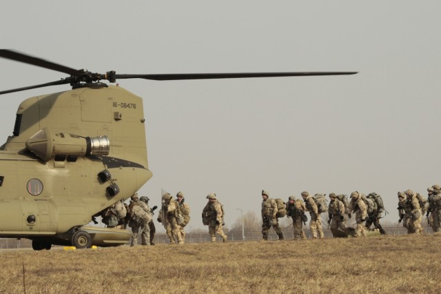 4th Battalion, 6th Infantry Regiment, 3rd Brigade Combat Team, 1st Armored Division Soldiers load into a CH-47 Chinook helicopter at Camp Humphreys, Republic of Korea, for an Air Assault training mission Jan. 7. This allows Soldiers to move tactically during their mission. Air Assault missions allows Soldiers to be strategically inserted in a controlled environments. (U.S. Army photo by Pfc. Edwin Petzke, 20th Public Affairs Detachment)
