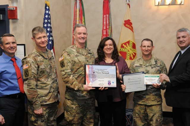 Fort Drum community members gathered Jan. 24 to recognize the accomplishments of civilian employees across the installation for the first quarter of fiscal year 2019 as well as the 2018 Outstanding Civilian of the Year recipients. Karen Harwood, a drug testing technician with the Army Substance Abuse Program, was named Outstanding Civilian of the Year for the GS 1-8 category. (Photo by Glenn Wagner, Fort Drum Visual Information)