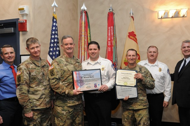 Fort Drum community members gathered Jan. 24 to recognize the accomplishments of civilian employees across the installation for the first quarter of fiscal year 2019 as well as the 2018 Outstanding Civilian of the Year recipients. Assistant Fire Chief Michael Marks, Directorate of Fire and Emergency Services, was recognized as Outstanding Civilian of the Year in the Supervisory category for his performance as a supervisory fire protection inspector. (Photo by Glenn Wagner, Fort Drum Visual Information)
