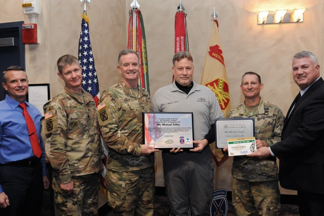 Fort Drum community members gathered Jan. 24 to recognize the accomplishments of civilian employees across the installation for the first quarter of fiscal year 2019 as well as the 2018 Outstanding Civilian of the Year recipients. Michael Tulley, supervisory safety and occupational health management specialist with the 10th Mountain Division Command Safety Office, was named Outstanding Civilian of the Year for the GS 9-12 category. (Photo by Glenn Wagner, Fort Drum Visual Information)