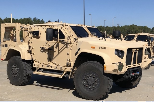 The first of six Joint Light Tactical Vehicles (JLTV) to be delivered to Soldiers from the 1st Armored Brigade Combat Team, 3rd Infantry Division, departs for the 1st Battalion, 41st Field Artillery Regiment motorpool. Raider Soldiers will sign for more than 350 JLTVs by the time the fielding is complete this spring.