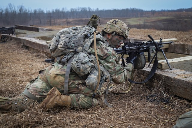 Pvt. David, Montoya, a squad automatic weapon gunner with Alpha Company, 2nd Battalion, 506th Infantry Regiment, 3rd Brigade Combat Team, 101st Airborne Division (Air Assault), awaits orders amid firing at distance targets at Fort Campbell, Ky., Jan 16.