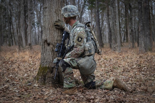 Sgt. David Penney, a Squad Leader with 2nd Battalion, 506th Infantry Regiment, 3rd Brigade Combat Team, 101st Airborne Division, takes cover behind a tree during the battalion-level Live Fire Exercise Jan. 16.