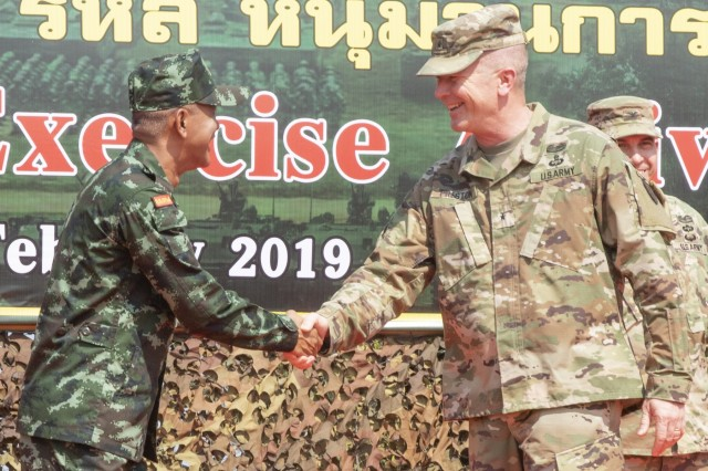 Colonel Chitsanupong Rodsiri, the Deputy Commanding General for 2nd Infantry Division King's Guard, Royal Thai Army, and Brig. Gen. Andrew Preston, the Deputy Commanding General - Support for 25th Infantry Division, shake hands during the Hanuman Guardian opening ceremony, Jan. 28, 2019, at Camp Nimman Kolayut, Thailand. Hanuman Guardian 2019 was a training exercise with the Royal Thai Army designed to enhance military-to-military partnerships, interoperability and mission readiness. (U.S. Army photo by Staff Sgt. Samuel Northrup)