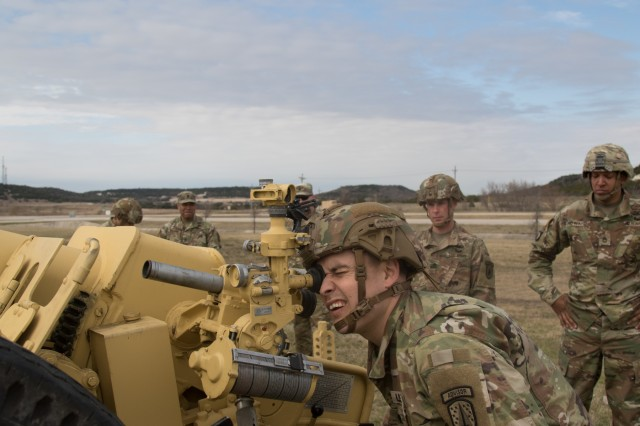 U.S. Army Staff Sgt. James Hall, an artillery adviser with the 3rd Security Forces Assistance Brigade, looks through the sight to ensure proper alignment of the collimator, the primary aiming reference being utilized with a 122mm Howitzer 2A18 (D-30) during a training exercise at Fort Hood, Texas on Jan. 10, 2019. The artillery team with the 3rd SFAB is working up to their first deployment to train with and advise foreign security forces across the world.