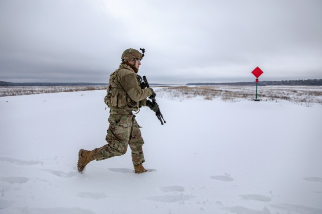 U.S. Army Sgt. Charles Hodgson, a Task Force Raider infantrymen from Pleasant View, Tenn., bounds through the snow during a react to contact training exercise for Operation Raider Lightning at Bemowo Piskie Training Area, Poland, Jan. 17. Raider Lightening is a series of live-fire training exercises, day and night, conducted to better enhance combat readiness operations in even the most inconvenient terrain and circumstance.
