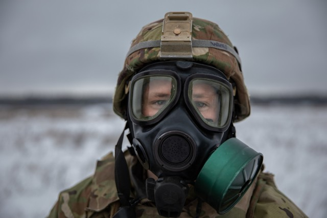 U.S. Army Spc. Adam Wims, a Task Force Raider infantrymen assigned to Battle Group Poland, dawns his pro-mask during a training exercise for Operation Raider Lightning at Bemowo Piskie Training Area, Poland, Jan. 17. Raider Lightening is a series of live-fire training exercises, day and night, conducted to better enhance combat readiness operations in even the most inconvenient terrain and circumstance.