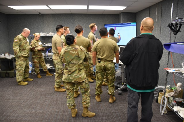 Before patient arrival, test participants with the 44th Medical Brigade studied patient information on the Medical Hands-free Unified Broadcast device. MEDHUB was provided to the test participants for half of the mass casualty scenarios so evaluators could study its impact on patient treatment.
