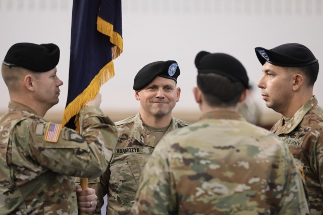 Command Sgt. Maj. Justin A. Conner (left), Lt. Col. Matthew T. Adamczyk (center left), Lt. Col. Robert K. Tracy (center right), Col. Joseph E. Escandon (right) stand ready to pass the guidon during a Change of Command ceremony, Jan. 7 2019 at the Sgt. Leslie H. Sabo Jr. Physical Fitness Center, Fort Campbell, Kentucky. (U.S. Army photo by Maj. Kevin T. Andersen)