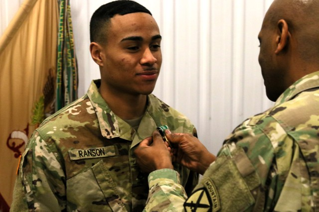 Lt. Col. Anthony L. Wilson, the 548th Combat Sustainment Support Battalion commander, presents the Army Commendation Medal to Pfc. D'Marcus Ranson, a motor transport operator assigned to the 110th Composite Truck Company, on Fort Drum, N.Y. for his quick intervention to render life-saving first aid on Dec. 25, 2018 in Lubbock, Texas.