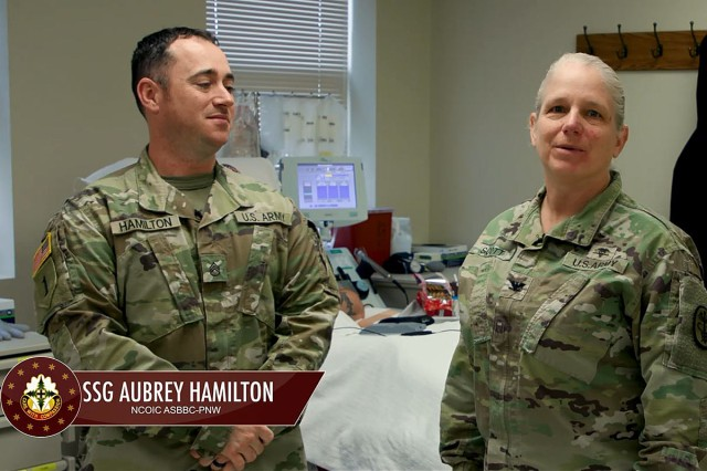 Col. Suzanne Scott, deputy commanding officer, Madigan, gets all the information Jan. 10 on blood donation in the latest episode of Madigan Works! from Staff Sgt. Aubrey Hamilton, the noncommissioned officer-in-charge of the Armed Services Blood Bank Center-Pacific NW.