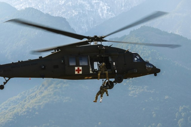 U.S. Army Sgt. 1st Class Jessie Turner, a flight paramedic with the 2nd General Support Aviation Battalion, 4th Aviation Regiment, 4th Combat Aviation Brigade, 4th Infantry Division, is hoisted up into a HH-60 Black Hawk helicopter at Litochoro, Greece, Jan. 23, 2019. Regionally allocated forces conduct training regularly to maintain readiness and lethality, and participate in future training exercises with partners and allies.