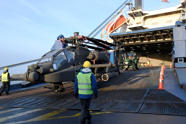 SDDC personnel tow an AH-64 Apache helicopter from the American Roll-On/Roll-Off Carrier vessel Endurance during port operations at the Port of Zeebrugge, Belgium Jan 29, 2019.