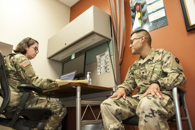 1st Lt. Audrey Poulton, nurse practitioner, Department of Primary Care, William Beaumont Army Medical Center, asks a series of health-related questions to Spc. Samuel Serrano at the Spc. Hugo V. Mendoza Soldier Family Care Center, Fort Bliss, Texas, April 13, 2018.