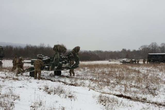 2nd Section,  1st Platoon, Bulldog Battery, Field Artillery Squadron, 2d Cavalry Regiment emplaces their howitzer in the Grafenwoehr Training Area, Germany, Jan. 9, 2019. On the first day of table XII certifications, first platoon led the battery in completing its live fire missions, followed by second platoon on day two of execution.  (U.S. Army photo by 1st. Lt. Dana Robertson, Bulldog Battery)