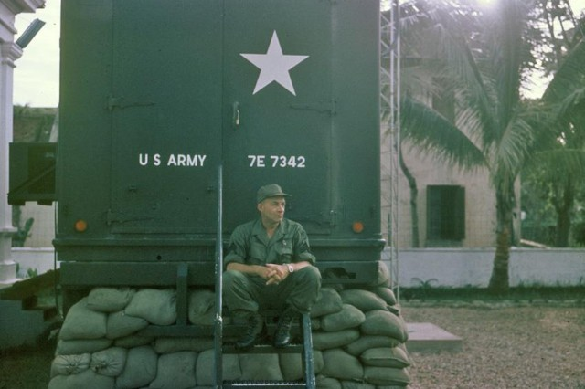 Broadcast Engineer Staff Sgt. Donat Gouin sits behind the television van for Detachment 5 of the American Forces Vietnam Network in Hue.